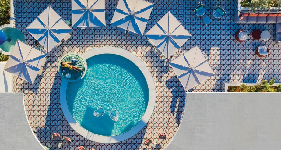 Bask in the sun at the Moxy's eighth-floor rooftop pool PHOTO BY MICHAEL KLEINBERG